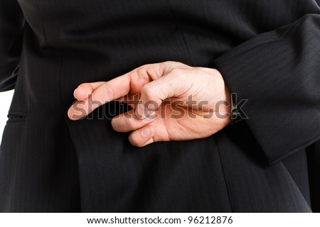 Man with his fingers crossed - stock photo