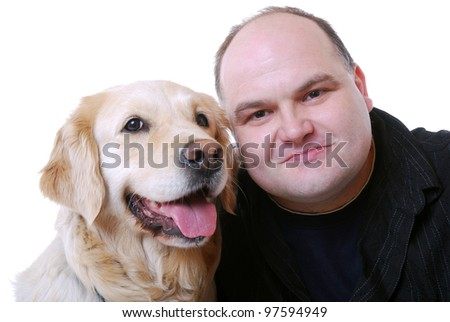 man with his golden retriever - stock photo