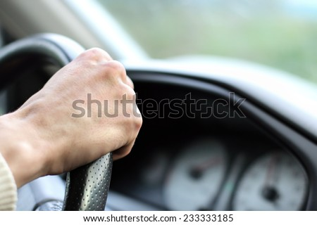 Man with his hand on the wheel