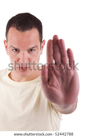 man with his hand raised in signal to stop, isolated on white background, Studio shot - stock photo