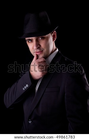man with his hand to his lips in a seductive pose - stock photo