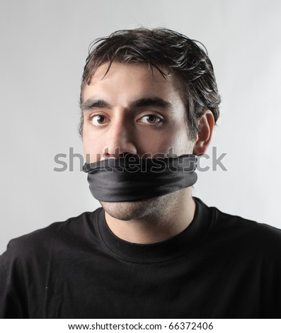 Man with his mouth folded - stock photo