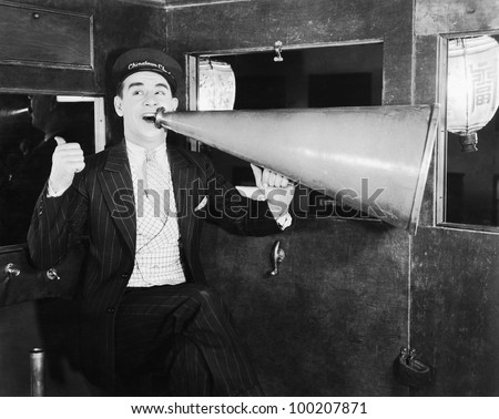 Man with huge megaphone - stock photo