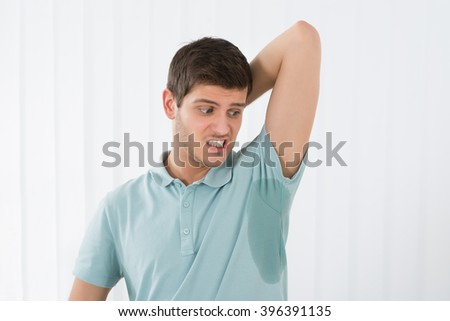 Man With Hyperhidrosis Sweating Very Badly Under Armpit - stock photo