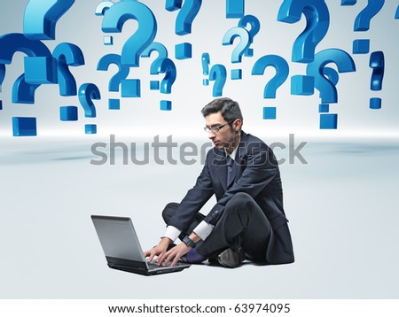 man with laptop and 3d question mark background