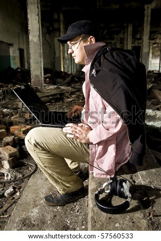 man with laptop in industrial place - stock photo