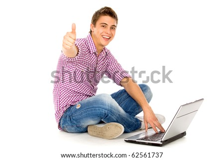 Man with laptop showing thumbs up - stock photo