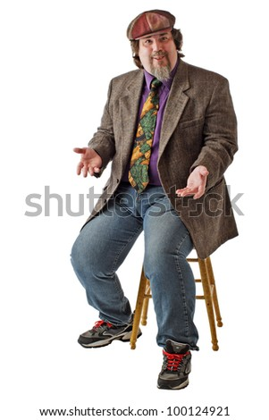 Man with large build sits on stool, dressed casually in tweed cap, jacket and jeans. He shrugs with palms up. Vertical, isolated on white background, copy space.