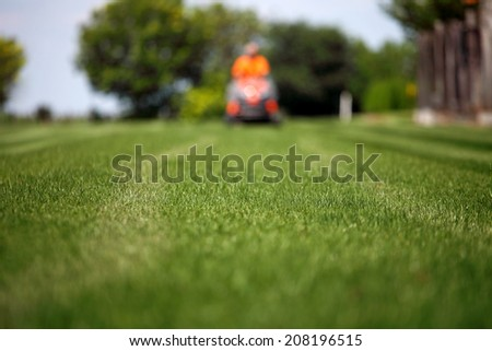 man with lawn mower 3 - stock photo