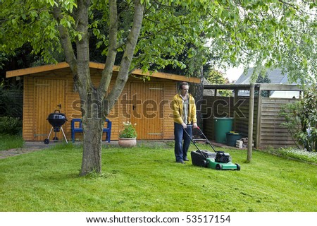 man with lawnmower - stock photo