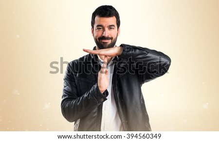 Man with leather jacket making time out gesture