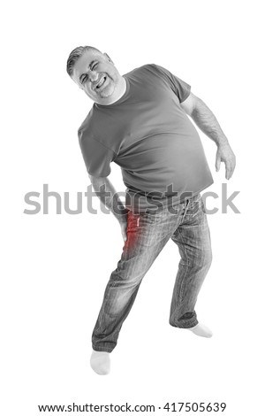 Man with leg muscle pain. Muscle cramp in back thigh leg of a man. People, health-care and problem concept - unhappy man suffering. White background. Black & white picture. - stock photo