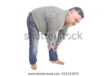 Man with leg muscle pain. Muscle cramp in back thigh leg of a man. People, health care and problem concept - unhappy man suffering. White background. Full length picture.