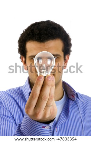 man with light bulb on hand - focus on lamp - stock photo