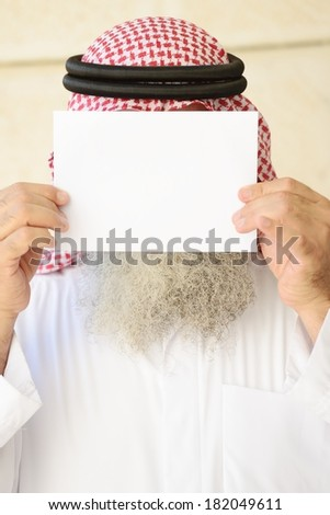 Man with long beard posing with empty copy space paper on his face