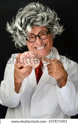 Man with long hair and brain/Crazy Genius Professor with Brain/Demonstration of the powerful brain - stock photo