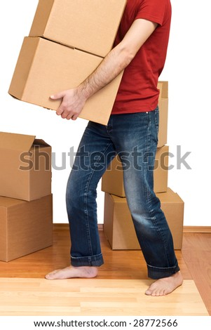 Man with lots of cardboard boxes - moving concept - stock photo
