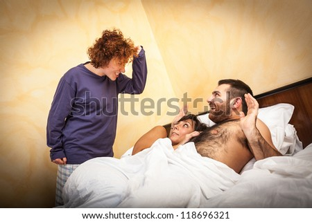 Man with Lover Caught by his Wife - stock photo
