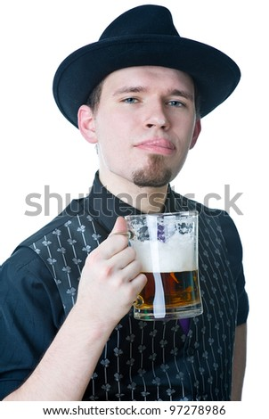 Man with mag of beer licking lips