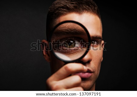 Man With A Magnifier Stock Photos - Image: 35891403