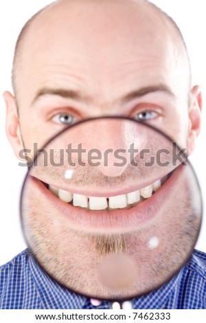 Man with magnifying glass held up to face, enlarging mouth and chin