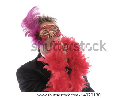 man with mask, feather boa and bow tie