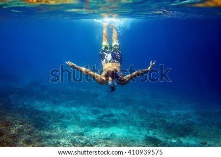 man with mask swimming underwater in tropical sea. vacation concept - stock photo