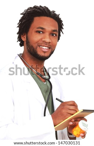 Man with medicine and a note pad - stock photo