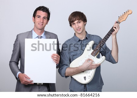 man with message and boy with guitar - stock photo