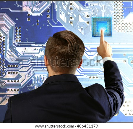 Man with microchip and electronic circuit board, close up