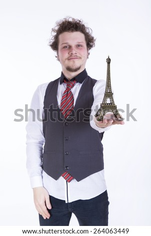 man with miniature Eiffel tower on white background - stock photo