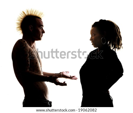 Man with Mohawk and Woman wearing Dreadlocks