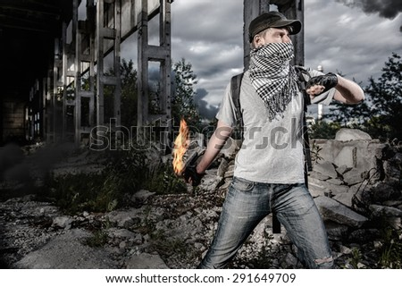 Man with Molotov cocktail - stock photo