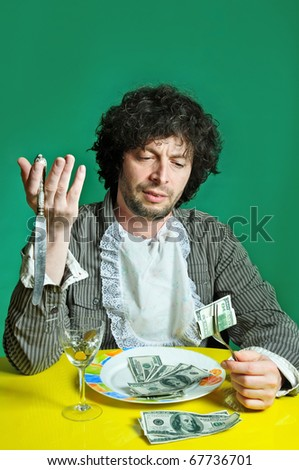 Man With money on the dish inside of food. - stock photo