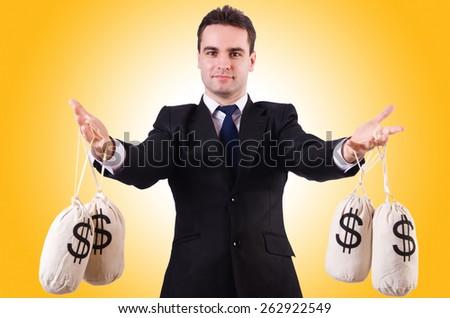 Man with money sacks on white - stock photo