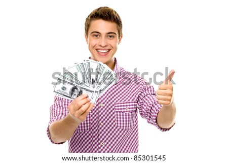 Man with money showing thumbs up - stock photo