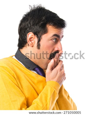 Man with moustache covering his mouth  - stock photo