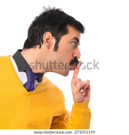 Man with moustache making silence gesture  - stock photo