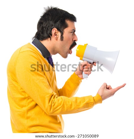 Man with moustache shouting by megaphone   - stock photo