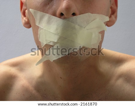 Man with mouth covered by masking tape preventing speach. - stock photo