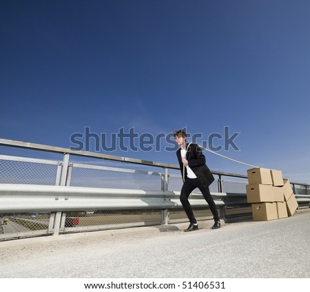 Man with Moving Boxes Outdoor - stock photo