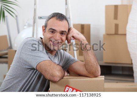 Man with moving cartons - stock photo