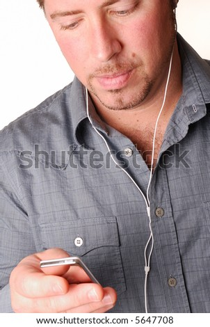 man with mp3 player and white headphones - stock photo