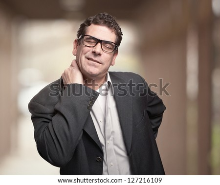 Man with neck and back pain injury - stock photo