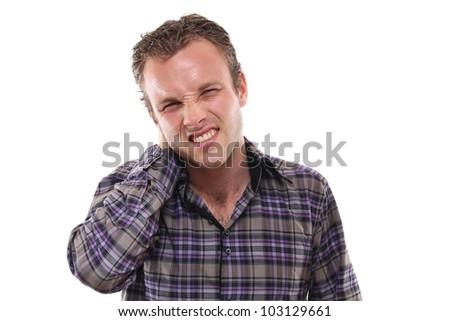 Man with neckache - stock photo