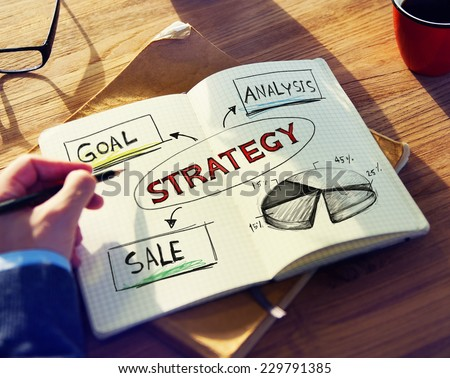 Man with Note Pad and Strategy Concept - stock photo