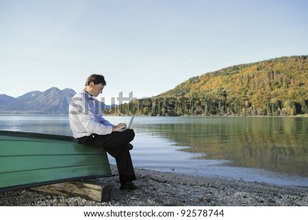 man with notebook is sitting on a boat