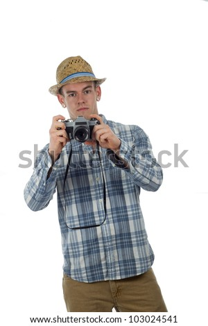 Man with old 35mm camera poses as tourist - stock photo