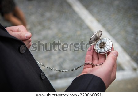 man with old pocket watch - stock photo