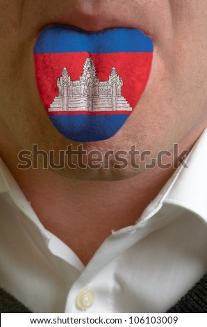 man with open mouth spreading tongue colored in cambodia flag as symbol of values like teaching, learning, multilingual speaking of different languages - stock photo